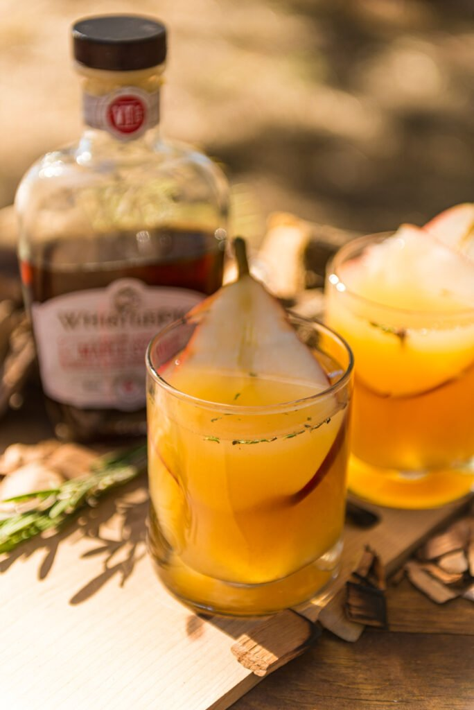Pear and white wine sangria in glass with a slice of fresh pear