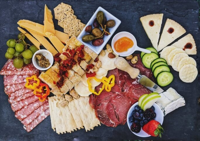 A perfect charcuterie board! with cheese, capers and meats