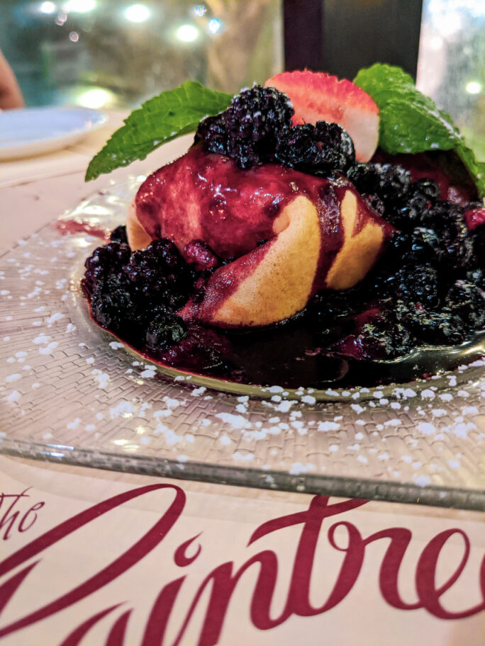 Massive berry filled crepes you do NOT want to miss at the Raintree restaurant