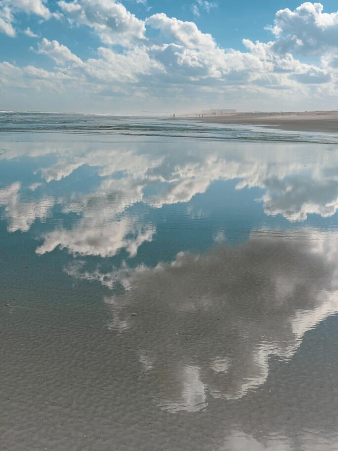 Reflection of the sky in the smooth waters of Anastasia state park beach